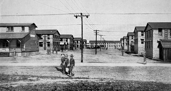 SOLDIERS WALKING barracks in background 1
